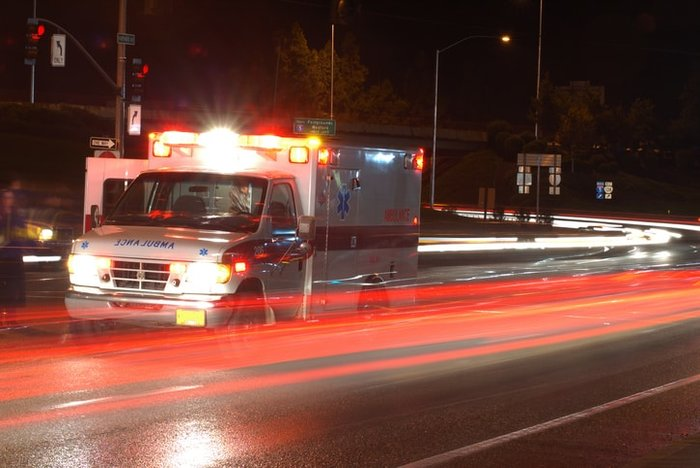 Ambulance driving down the road showing motion | Role of battery-powered aspirators