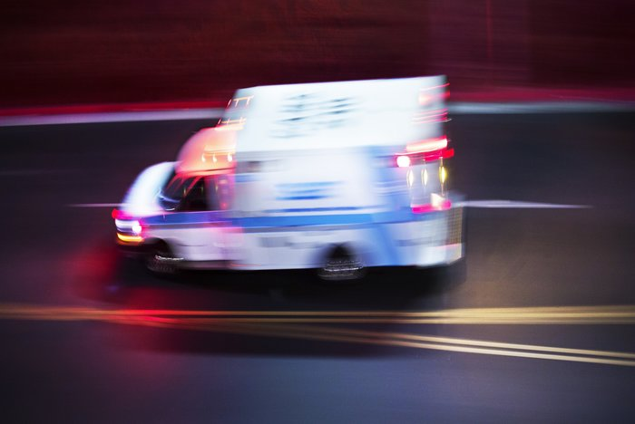 Blurry photo of ambulance speeding to emergency scene