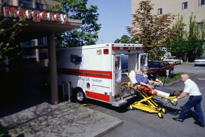 Patient arriving at hospital - treating head injuries using emergency suction pump